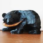 鮭咥え熊 木彫り風貯金箱(黒)