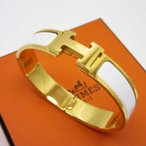 エルメス HERMES ブレスレット バングル クリッククラックPM 金属素材 ゴールドxホワイト 定番人気