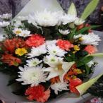 白いユリ・白輪菊・黄色・白小菊などをmixした供花の花束をお届けします。