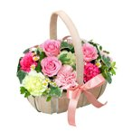 アレンジメント-511575 (ピンク系のお花が中心のリボンのついた可愛らしいアレンジメント)花キューピット商品