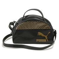 若い女性の間で流行の小ぶりのハンドバッグ。 着脱可能なショルダーストラップ付き。ブラックとゴールドの...