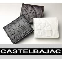 クロコの型押しを施した牛革を使用したコインケース。 家紋マークが素押しで表現され、内部にはカステルバ...