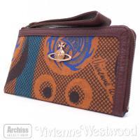 ヴィヴィアンウエストウッドの素敵な札入れ財布・ポーチです。オレンジっぽい茶のフェルト地にエスニックな...