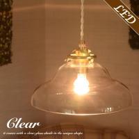 クリアーのガラスシェード。そして...ゴールド仕上げの灯具。とってもレトロでかわいい1灯のペンダント...