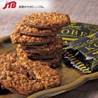 関西のお土産 ほんのりビターなチョコレートのクッキー生地にキャラメルを絡めたナッツをトッピングしまし...