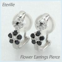 フラワーモチーフのダイヤモンドイヤリングピアス。 ダイヤとブラックダイヤ6石と5石を使って1つの花を...