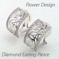 フラワーモチーフのダイヤモンドイヤリングピアス。  薔薇の花を地金を使った透かし模様で表現しました。...