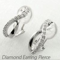 シンプルなデザインのダイヤモンドイヤリングピアス。  滑らかな2本の地金のラインが8の字にクロスした...