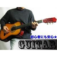 木製のギターです!中央には細かな模様が施されています☆一人での安らぎに♪音楽を通して素敵な時間を!ギ...