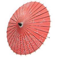 エンジみの赤地に舞い散る桜花弁を描いた柄紙傘です。ご覧のように、素朴な手作り感があります。持ち手や骨...