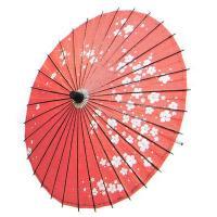 赤(茜)地に梅花冠を散らした飾り紙傘です。ご覧のように、素朴な手作り感があります。持ち手や骨組み、ろ...