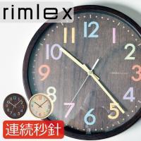 時計の老舗メーカー『noa精密』の木目調の文字盤にカラフルなポップな数字が特徴の掛け時計です。  文...