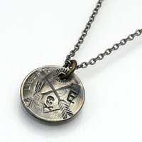USダイムコインを象ったペンダントトップに、ニューメキシコ「タオスプエブロ」のネイティブから譲り受け...