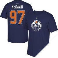 NHLプレイヤーユニフォームをモチーフにしたネームナンバーTシャツ。 フロントにチーム名とNHLオフ...