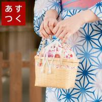 可愛い花柄の巾着付き♪ 木の風合いが夏の雰囲気にとても合うかごバッグ。持ち手の紐は本体と同色の、落ち...
