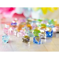 フルーツゼリーみたいに煌めく透明感にうっとり☆夢かわいいガラス製キューブパーツ!    裏のフォイル...
