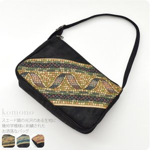 スエード調の光沢のある生地に幾何学模様に刺繍されたお洒落なバッグです。 和装はもちろん、洋装にもお使...