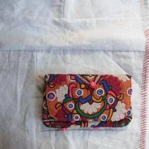 バンジャラミラーワーク刺繍 ポンポンクラッチバッグ|abracadabra