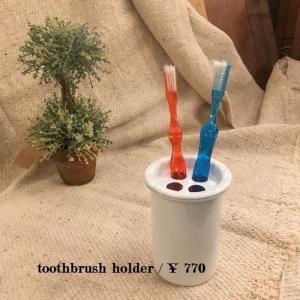 Enameled toothbrush holder|abracadabra