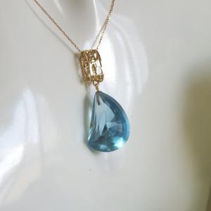 透かし模様バチカン ブルートパーズ(変形カット) K10ゴールドペンダントトップ(ヘッド)1点もの|airejewelry