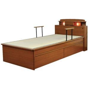 ヘッドボードに小引出しやコンセント付ライト付。ベッドでの立ち上がりや起き上がりが楽になる手すりが2本...