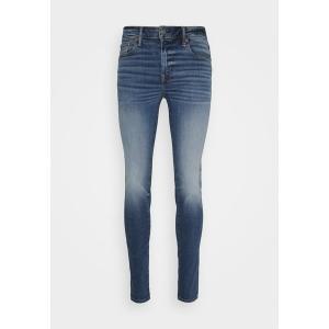 アメリカンイーグル デニムパンツ メンズ ボトムス CLEAN - Jeans Skinny Fit - medium tinted indigo|astyshop