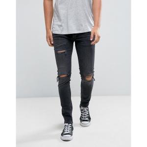 リバーアイランド メンズ デニム ボトムス River Island skinny jeans with rips in black wash Black|astyshop