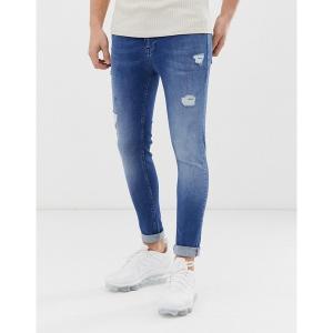エイソス メンズ デニム ボトムス ASOS DESIGN spray on jeans with power stretch in mid wash blue with abrasions Mid wash blue|astyshop