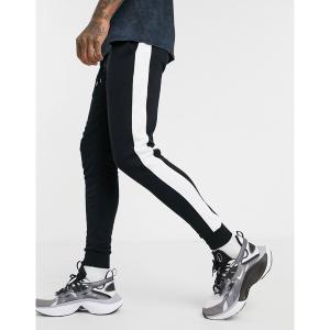 エイソス メンズ カジュアル ボトムス ASOS DESIGN skinny sweatpants with side stripe Black astyshop