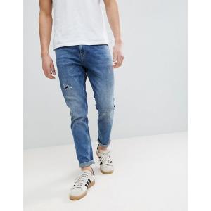 エイソス メンズ デニム ボトムス ASOS DESIGN tapered jeans in dark wash with rip & repair Dark wash blue|astyshop