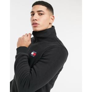 トミーヒルフィガー メンズ パーカー・スウェットシャツ アウター Tommy Jeans polar fleece badge logo half zip sweatshirt in black Black astyshop