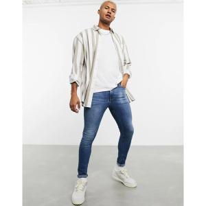 エイソス メンズ デニム ボトムス ASOS DESIGN spray on jeans in power stretch denim in mid wash blue Mid wash blue|astyshop
