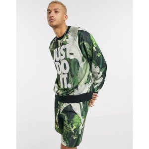 ナイキ メンズ パーカー・スウェットシャツ アウター Nike Just Do It crew neck sweat in tropical leaf print Tropical leaf print|astyshop