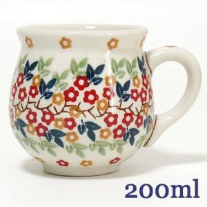 ポーランドからマグカップが入荷しました。 かわいらしい2色のお花が散りばめられた、 絵柄のカップです...