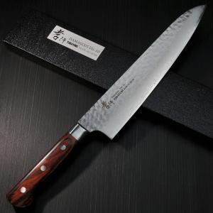 この包丁は日本刀のように異なった素材で形成され、33層ダマスカスと槌目模様、さらにマホガニーのハン...