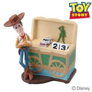ディズニー好きにはたまらない! トイストーリーの卓上カレンダー。 ダイスを持ったキャラクター達の姿が...