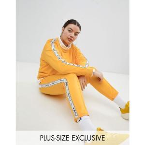 プーマ レディース スウェット・ジャージ ボトムス・パンツ Exclusive To ASOS Plus Taped Side Stripe Track Pants In Yellow Citrus|fermart
