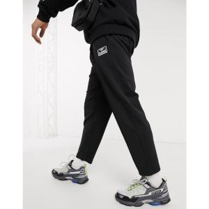 ヒュンメル Hummel メンズ クロップド ボトムス・パンツ Hive cropped trousers with drawstring waist in black ブラック|fermart