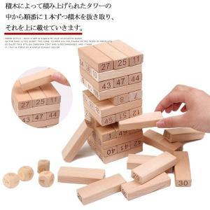 製品の説明 F:8.2*8.2*29  積木によって積み上げられたタワーの中から順番に1本ずつ積木を...