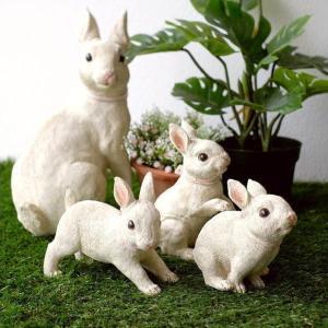 一生懸命親ウサギについて行く 子ウサギたちの姿が可愛い置物です  4匹のセット販売で 並べる角度や置...