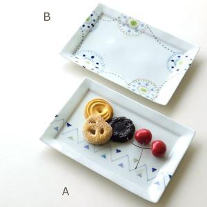 真っ白な白磁のプレートに 花模様とギザギザトライアングル模様の 可愛い手描きのプレートです  優しい...