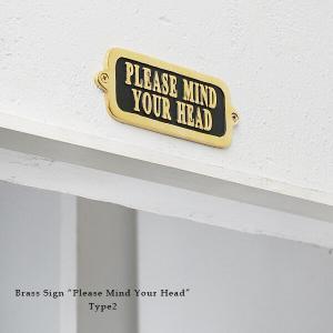「頭上注意」を促す真鍮製サイン。   英文にするだけで こんなにおしゃれになります。  黒塗装の台座...
