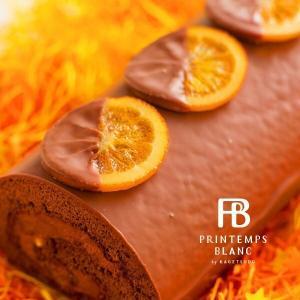 最高級ミルクチョコレートでコーティングしたスペイン産オレンジのシロップ漬を、スペシャルをロールケーキ...