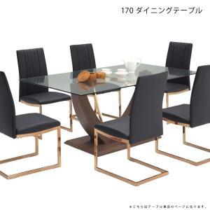 ガラスの美しい天板に 2本の湾曲した脚がしっかりと天板を支える独創的なデザインのダイニングテーブル ...