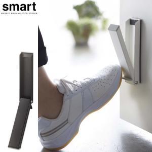 立ったまま操作できる、便利なマグネット式 玄関ドアストッパーです。スチール製のドアにマグネットで簡単...