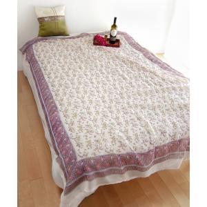 シースルー感のあるホワイトのコットンガーゼの布に、パープル&ピンクのフラワープリント。織り方に変...