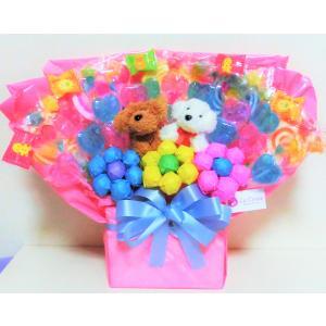 なかよしプードルさんが可愛くて美味しいキャンディーがつまったアレンジです。結婚式、誕生日、発表会、お...