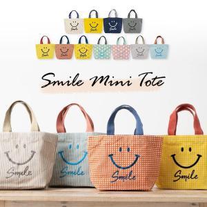 スマイルの刺繍がとってもキュートなミニトートバッグ。 オシャレ感のある夏らしい色の組み合わせと、持ち...
