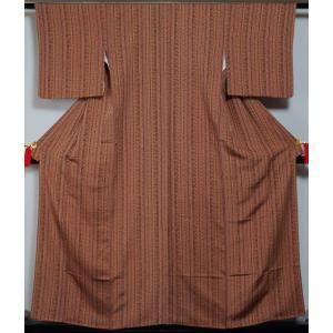 小紋 未使用品 縦付更紗・小花模様 茶色系 細身サイズ ちりめん  送料無料 中古 リサイクル着物 中古着物 リサイクル小紋 正絹 カジュアル 仕立て上がり|kimonotenyou
