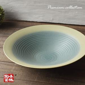 萬古焼の花器・水盤です。 オーソドックスな大皿で渋い緑の色合いが汎用性か高くどんな場面にも重宝します...